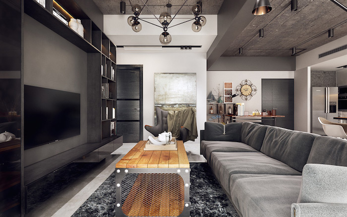 table basse industrielle en bois et metal, canapé et tapis gris, meuble tv gris amthracite. suspensions industrielles