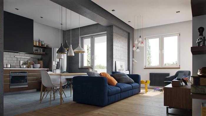 modèle de canapé pas cher еn bleu marine adossé à une cuisine en gris, blanc et bois, salon traditionnel avec parquet clair et meubles design, touches de déco industrielle