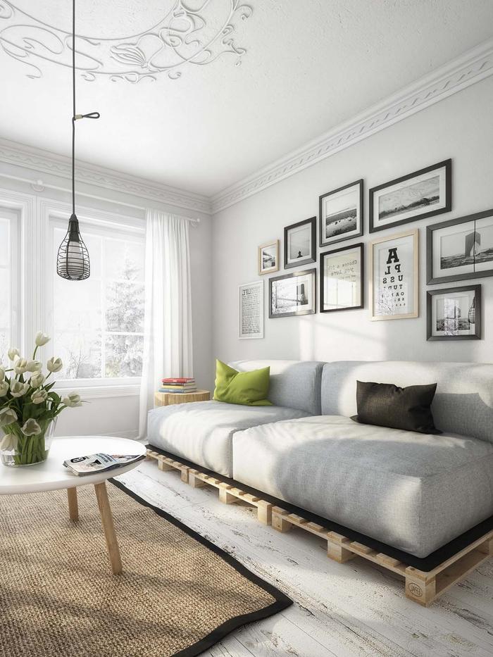 salon moderne en gris et blanc de style scandinave au design épuré avec un canapé en palette
