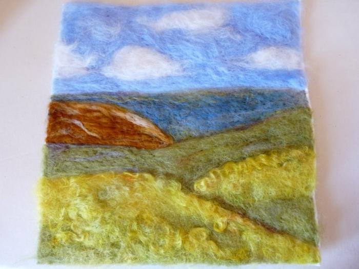 peinture en laine faite avec aiguille à feutrer, un paysage de nature