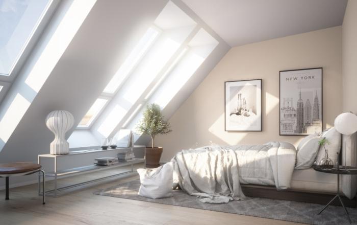 décoration de la chambre a coucher adulte sous pente avec grandes fenêtres de toit et revêtement de sol en bois