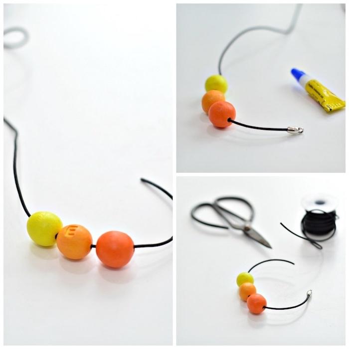 pate fimo bijoux en perles colorées en jaune et orange en monogramées enfilées sur un fil noir