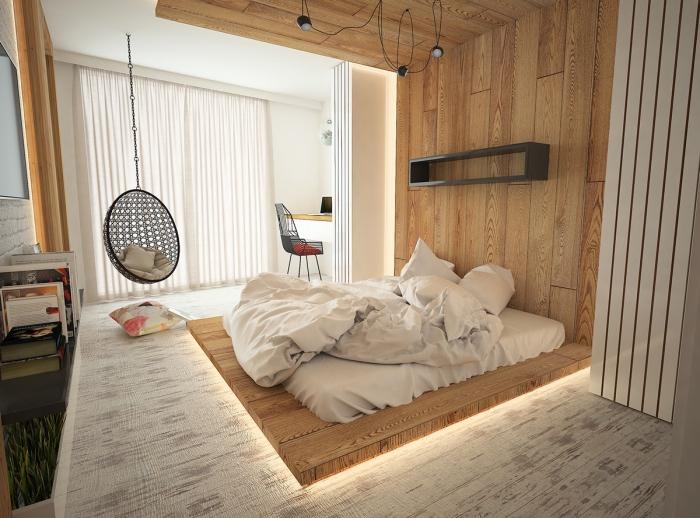 chambre complete adulte en style scandinave avec lit bas et chaise suspendue pour une ambiance cocooning