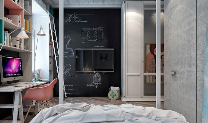 exemple de déco chambre avec un mur de fond en peinture à la craie et dessins, bureau scandinave, chaise rose et lit, ambiance artistique