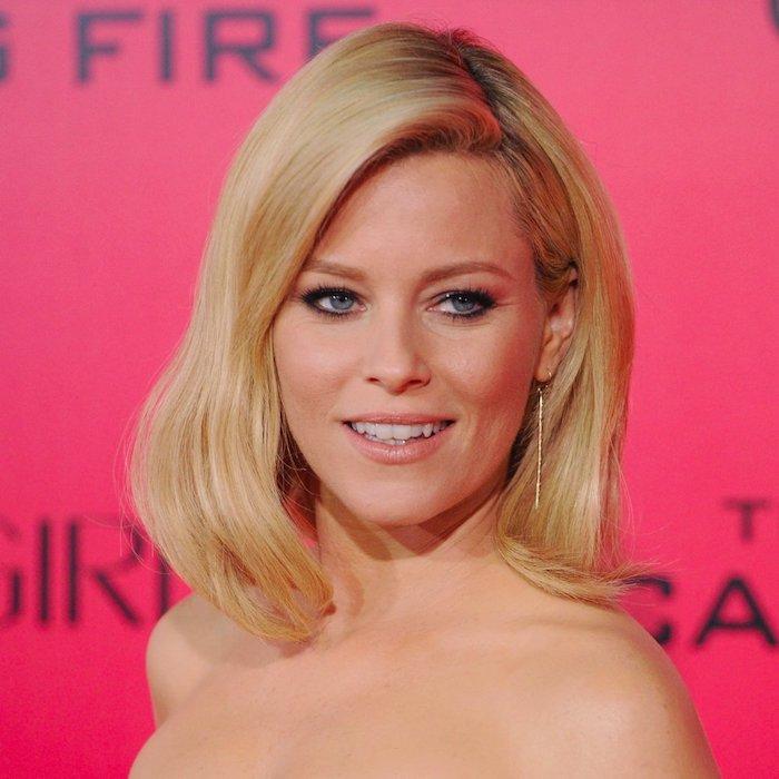 coupe carré plongeant femme cheveux blond avec longueur sur le devant et raie sur le côté