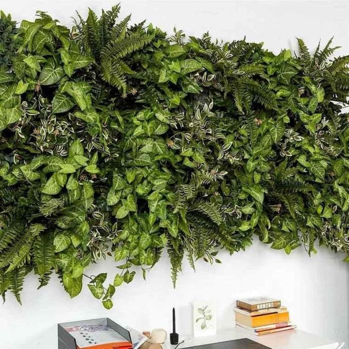 design intéressant de mur végétal intérieur avec des plantes vertes, mur blanc