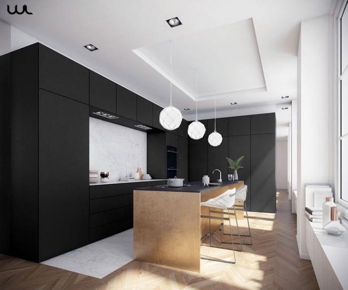 cuisine noir et blanc avec parquet et ilot central en bois, modèle de plafond blanc suspendu avec éclairage led