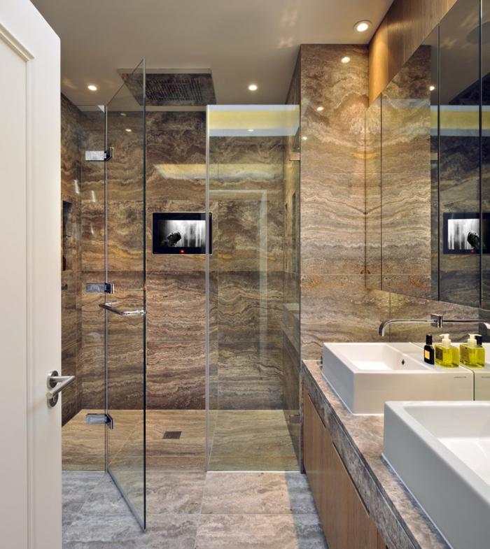 carrelage de travertin, deux vasques rectangulaires, parois de douche en verre, comptoir luxueux