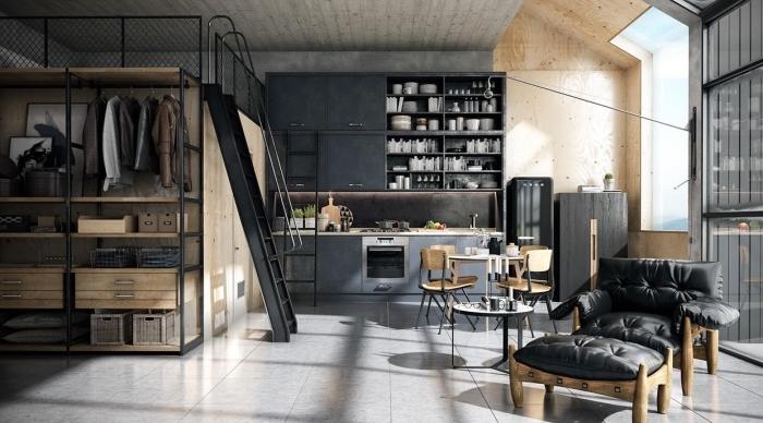 déco de style loft industriel avec fauteuil et tabouret en cuir noir et pieds en bois, petite table ronde en bois avec chaises