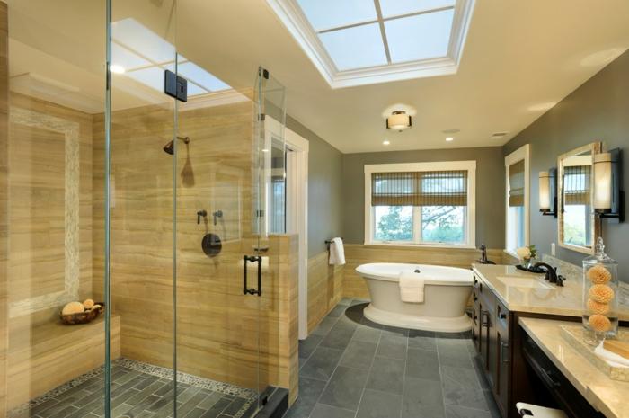 grand comptoir et mueble sous vasque, baognoire ovale, sol en carrelage gris
