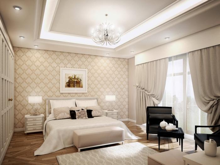 intérieur luxueux dans chambre complete adulte avec garde-robe encastrée de bois et plafond suspendu avec éclairage led