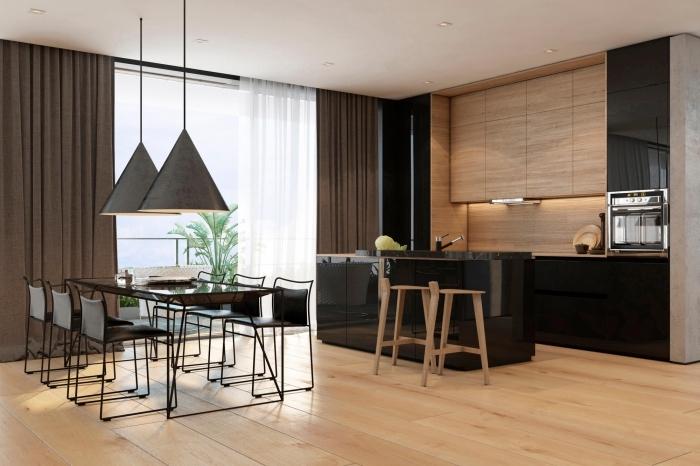 salle à manger ouverte vers la cuisine avec îlot central en noir et tabourets de bar de bois clair