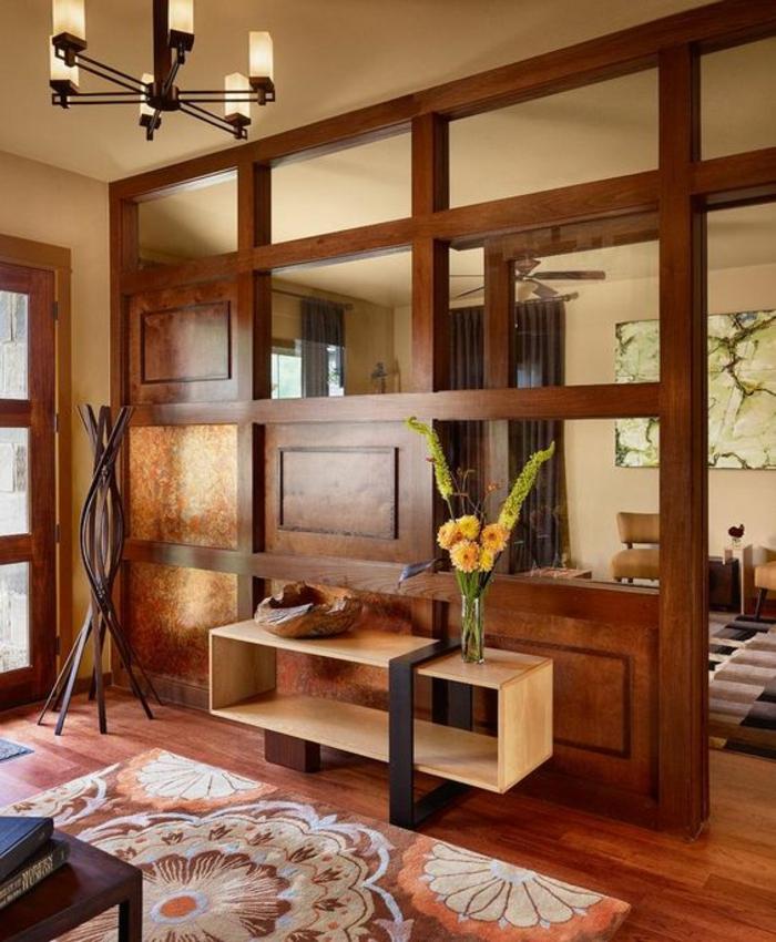 etagere separation en couleur marron, style vintage, tapis en corail, blanc et marron, table d'entrée en forme rectangulaire en bois clair et métal noir