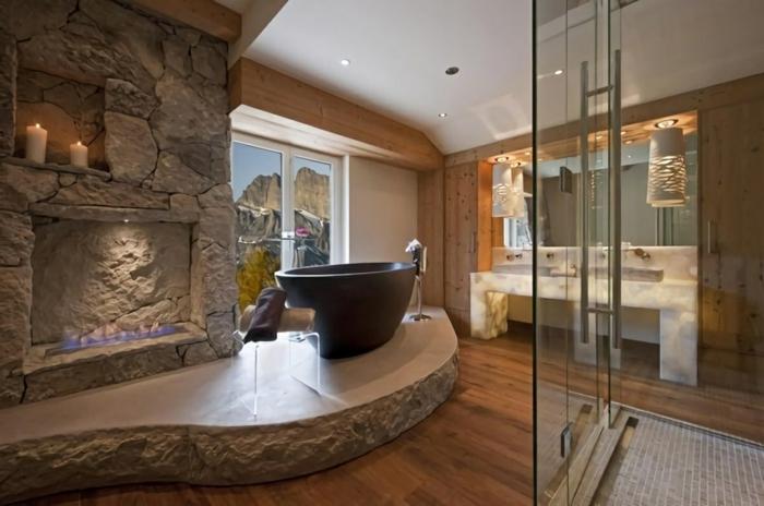 baignoire noire sur une plateforme impressionnante en pierre naturelle, pavement pierre naturelle spectaculaire