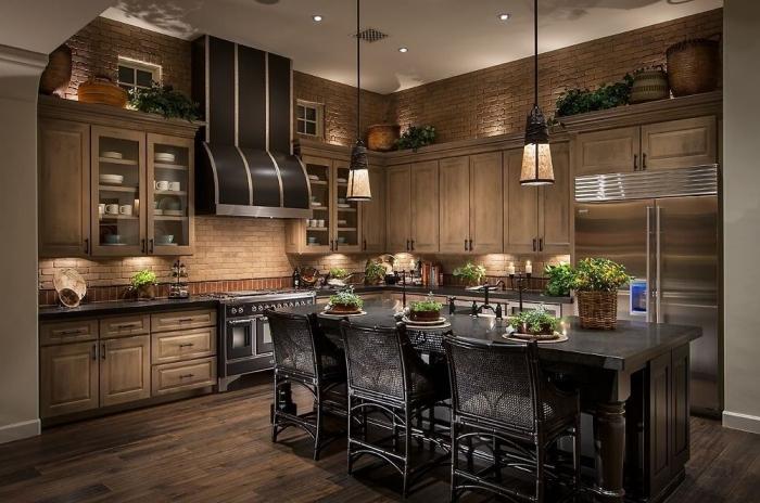 décoration intérieure de style campagne avec murs en briques rouge et plancher en bois foncé, modeles de cuisine