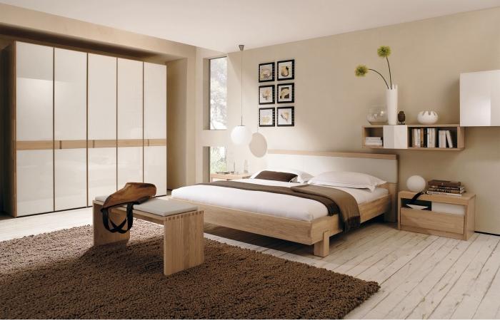 chambre design décorée en couleurs neutres et meubles de bois clair, modèle de garde robe blanche et bois