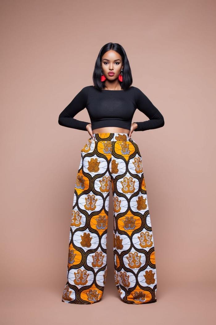 idée bijoux ethniques pour femme, modèle de pantalon large de style africain, tenue femme en top crop noir et pantalon ethnique