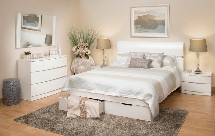 commode chambre adulte de couleur blanc sans poignées avec miroir, grand lit avec tiroirs et table de chevet