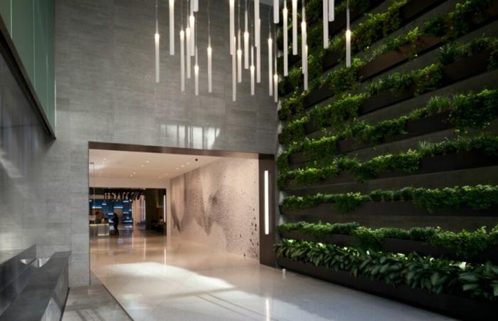 lampes suspendues, béton gris, architecture minimaliste et murs en béton, murs végétalisés