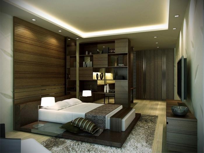 lit plateforme,tapis poilu, étagère en bois foncé, faux plafond suspendu, tete de lit haute