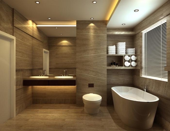 décoration de la salle de bain beige avec revêtement mural et plancher de bois clair, modèle de plafond suspendu blanc avec éclairage led jaune