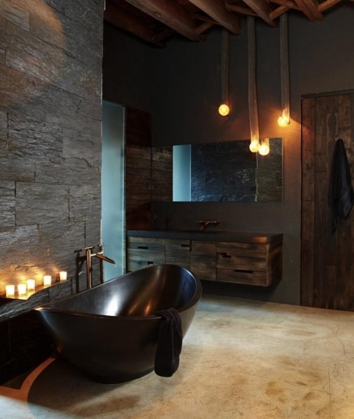 comment décorer une salle de bain sans fenêtre pour une ambiance relaxante, mur en pierre gris et meubles de bois massif foncé