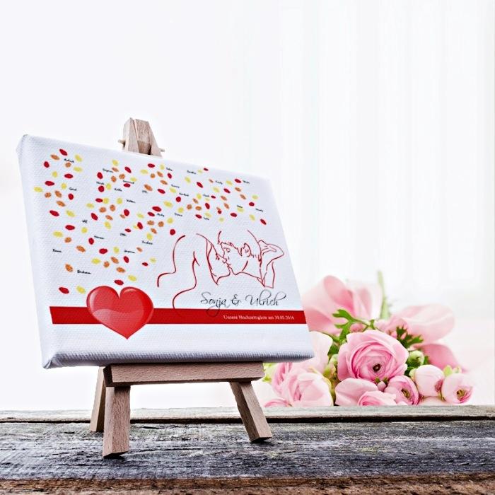 activité créative pour mariage avec un dessin à design visages couple jeunes mariés et empreintes en rouge et jaune