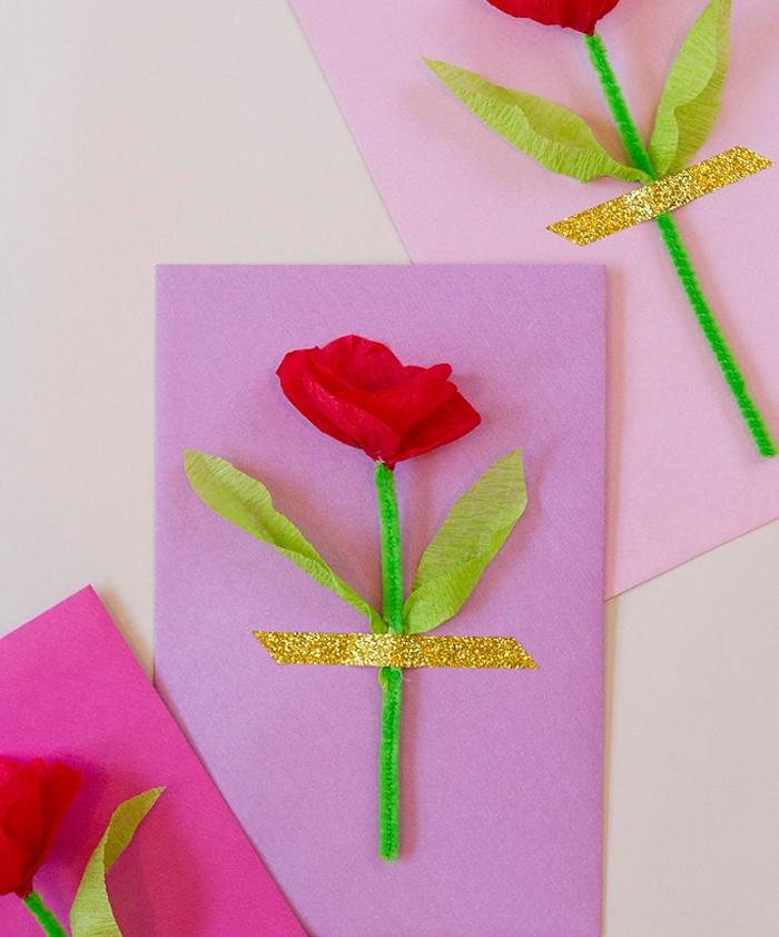 une carte de printemps a faire soi meme, activité manuelle primaire, fleur rouge avec tige verte en cure pipe et des feuilles vertes sur papier