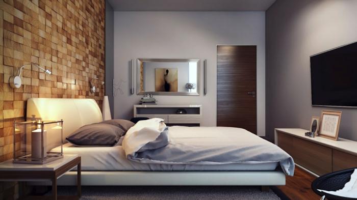 mur en briques, sol en planches de bois, peinture murale grise, bureau gris, tv murale