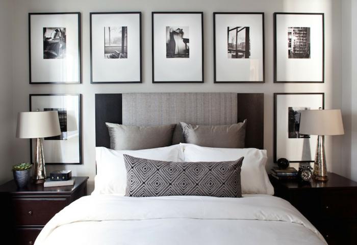 chambre à coucher en gamme monochrome, tableaux en noir et blanc, deux lampes abat-jour, chevets en bois foncé