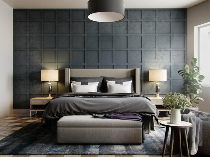 plafonnier noir, parement mural original, petite table scandinave, banquette de lit en tissu