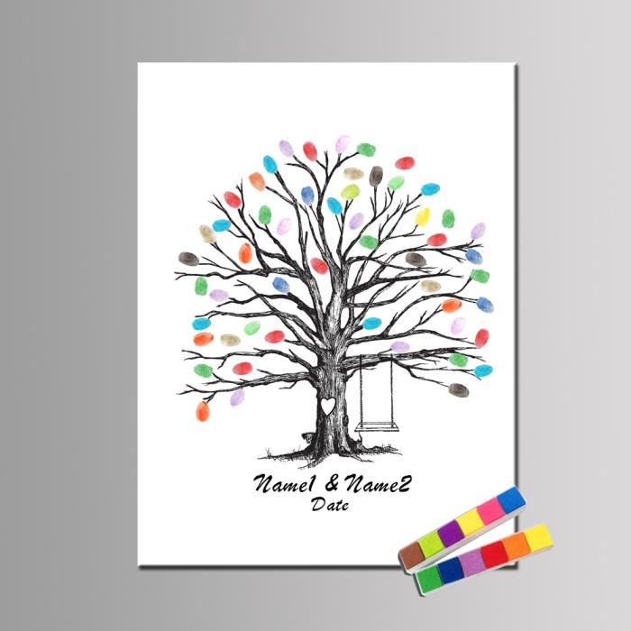 modèle de dessin blanc et noir avec un arbre sans feuillage et avec balançoire décoré d'empreintes en couleurs