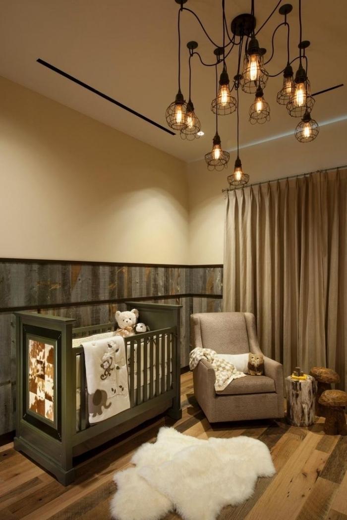 couleurs foncées et neutres dans la chambre complete bebe avec lit vert et fauteuil gris, modèle de tapis imitation peau blanche