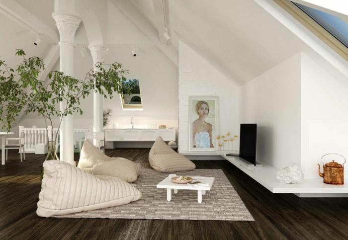 murs blancs, poufs poires beiges, petite table blanche, tapis beige, murs blancs