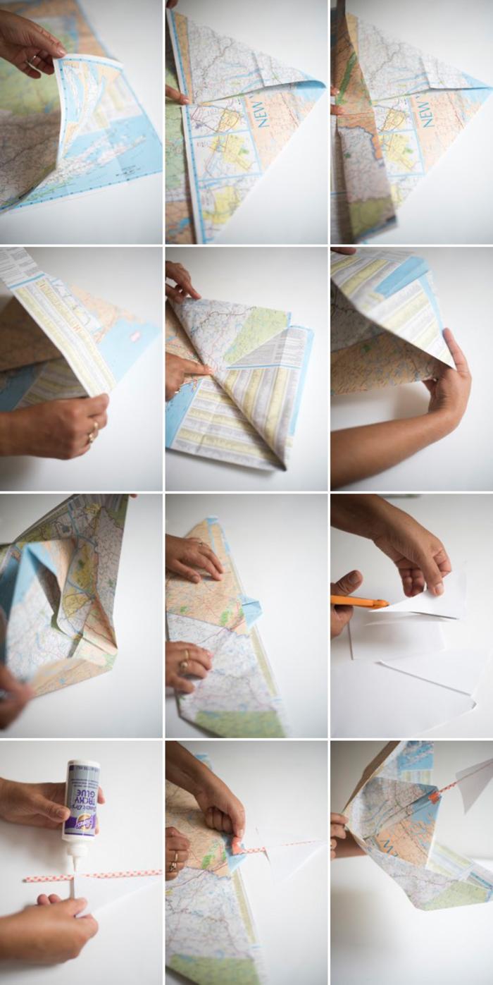 une déco origami pour la table sur thème marin avec des bateaux origami réalisés à partir d'une carte routière