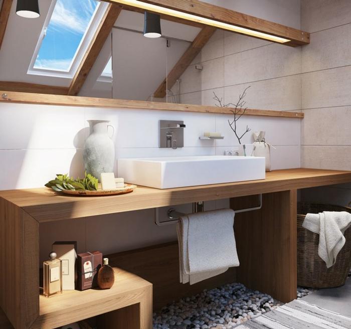 comptoir en bois, petit puits de lumière, vasque moderne en céramique, sol en petits galets