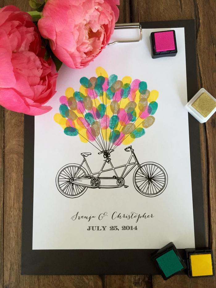 tampon encreur mariage en couleurs rose fuchsia jaune et verte pour réaliser des empreintes sur la feuille blanche