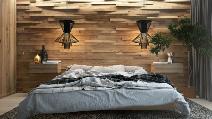 chambre parentale, revêtement mural bois, lampes pendantes noires, deux chevets flottants