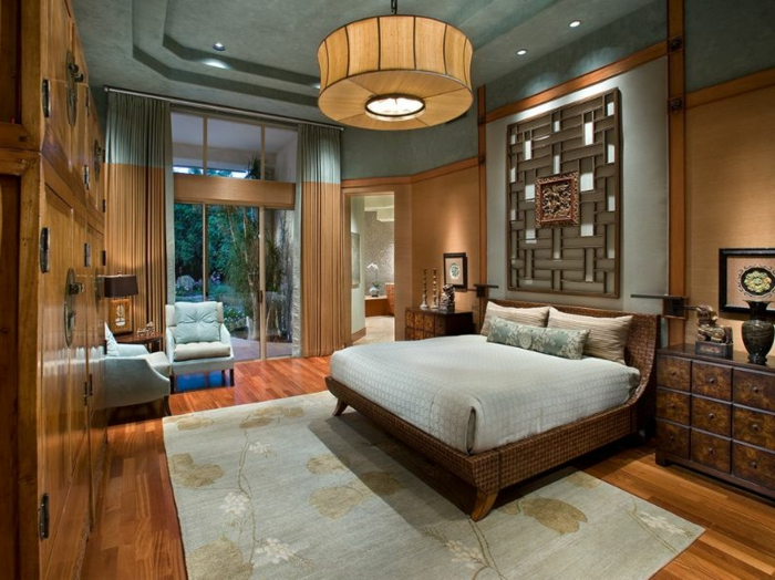 idée déco chambre parentale, lit en bois, tapis rectangulaire, sol en bois, murs en bois, faux plafond