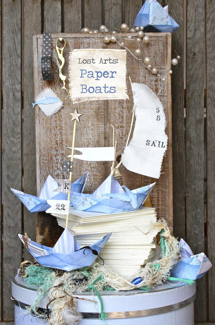 déco origami thématique pour un anniversaire ou un baby-shower marin avec de petits bateaux origami en bleu ciel