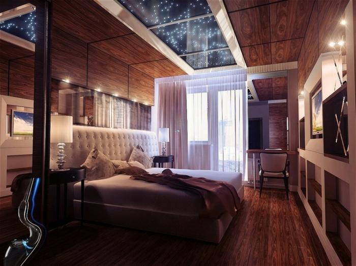 plafond étoilé, sol en bois foncé, poêle scandinave, parement mural bois, intérieur cosy et chic