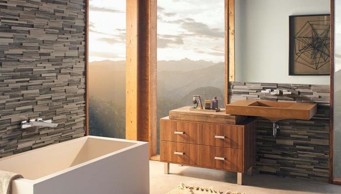 plan de déco de la salle de bain moderne avec grande fenêtre et mur en pierre, meubles sous lavabo de bois marron