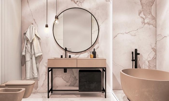 décoration monochrome de nuance marbre rose avec meubles moderne et accessoires à finitions métalliques noir mate