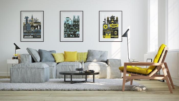 quelle couleur associer au gris perle, mur blanc décoré d affiches publicitaires, tapis et canapé gris, chaise en bois avec coussin jaune, parquet clair