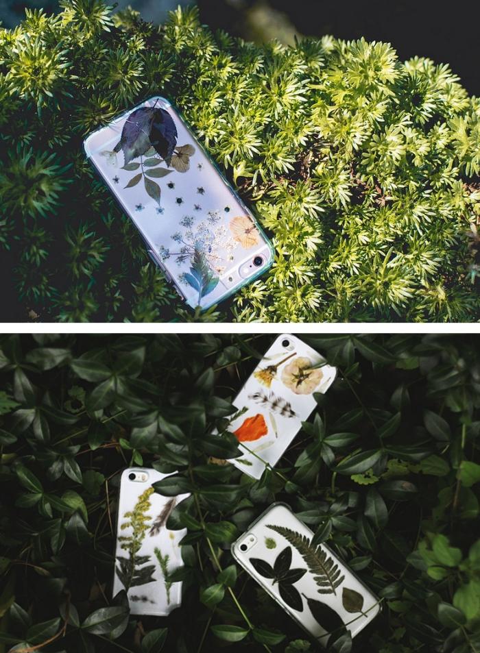 activité manuelle découpage avec fleurs et feuilles vertes séchées collées sur une coque de portable blanche