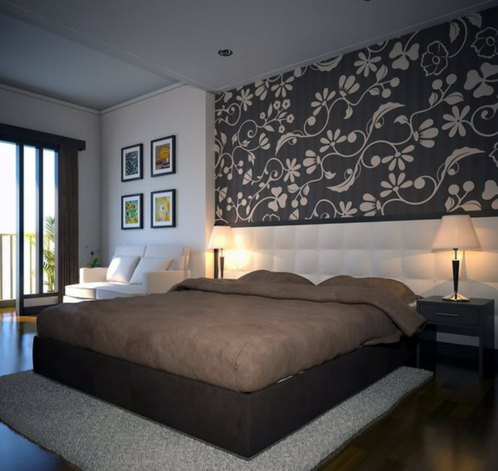 lit en beige, tapis et sol en bois, tête de lit longue blanche, tableaux encadrés