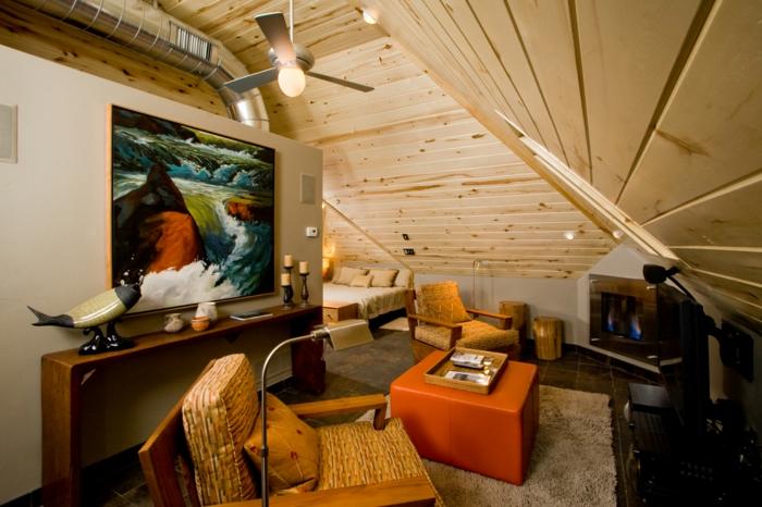 aménagement sous les combles, ambiance créée avec du bois clair, paysage encadré et meubles bas