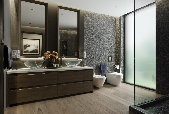 élégance et confort dans une salle de bain en couleurs foncées avec cabine de douche en verre, meuble sous vasque de bois foncé