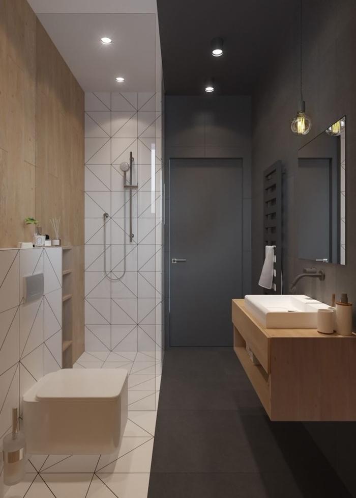 déco stylée en blanc et gris anthracite mate avec revêtement partiel de mur en bois clair, meuble sous lavabo blanc et bois