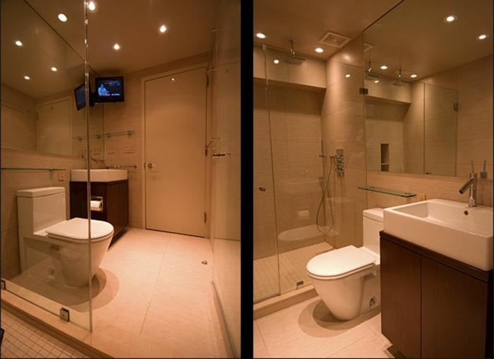 éclairage au plafond, tv montée, salle de bain en couleurs neutres, vasque en céramique